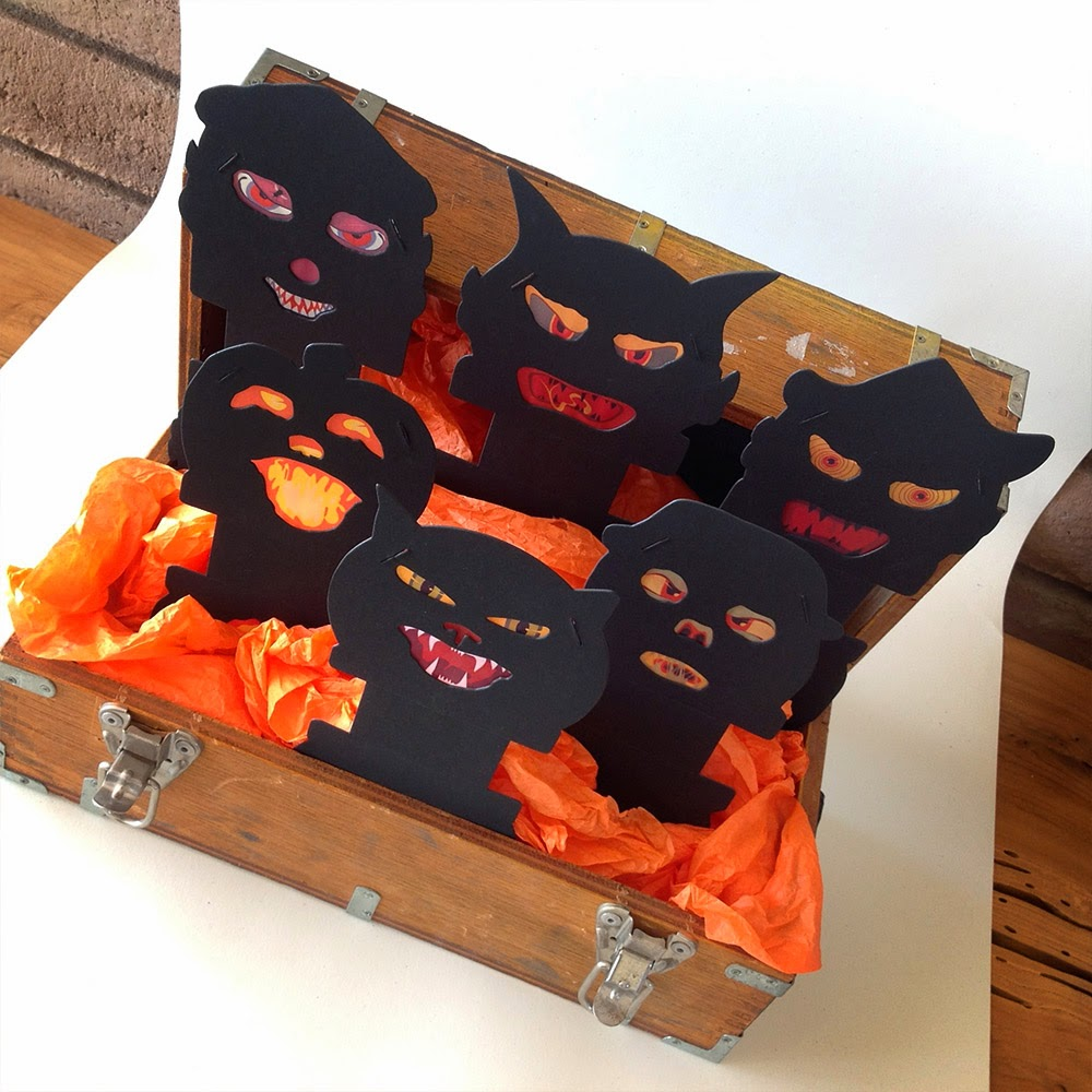 Family of silhouette creeps with light-up eyes, nose, mouth, make up this vintage style set.