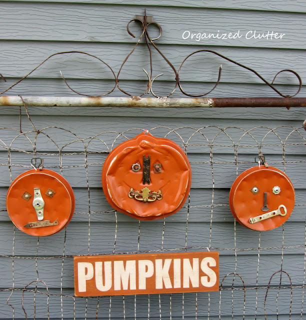 Trio of Junk Pumpkins on a Rusty Gate
