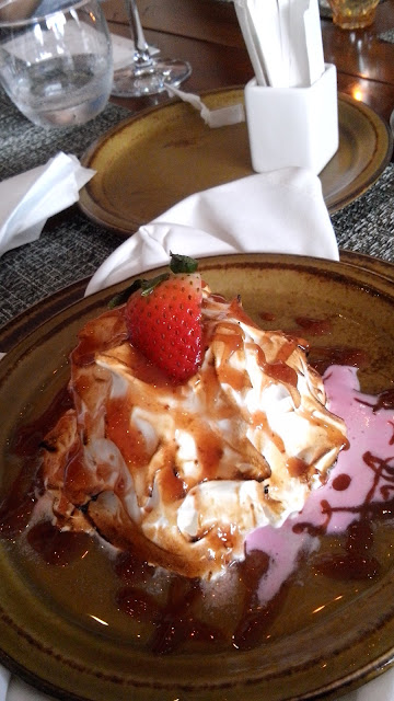 cowrie grill, Baked Alaska Strawberry and vanilla ice cream, sponge cake browned meringue, flambe with brandy