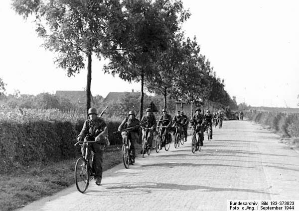 "Bicycle mounted Waffen-SS Soldaten (SS Soldiers) ride towards ""Arnhem"", September 1944"