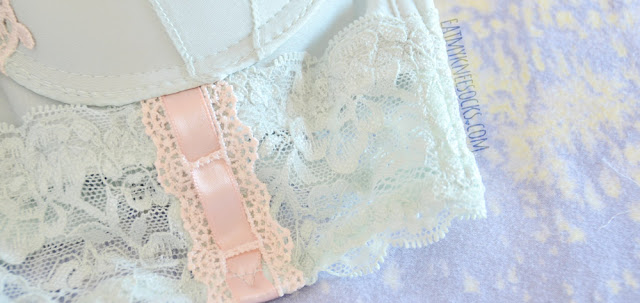 Close-up of the contrasting pastel pink ribbon and lace detailing on the mint green/aqua Leanne longline bustier bra from Petite Cherry.