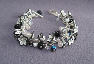 A pretty charm bracelet with little cup shaped polymer clay flower beads