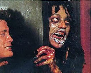 Geretta Geretta Demons Demoni Italian film 1985 Scary zombie vampire demon tries to break into room guy holds door.