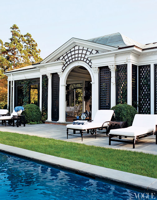 exterior of a pool house with trellis detailing