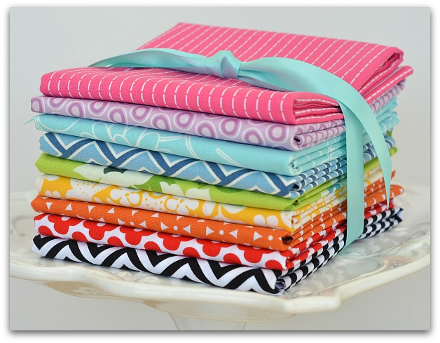 rainbow stack of modern quilting fabrics