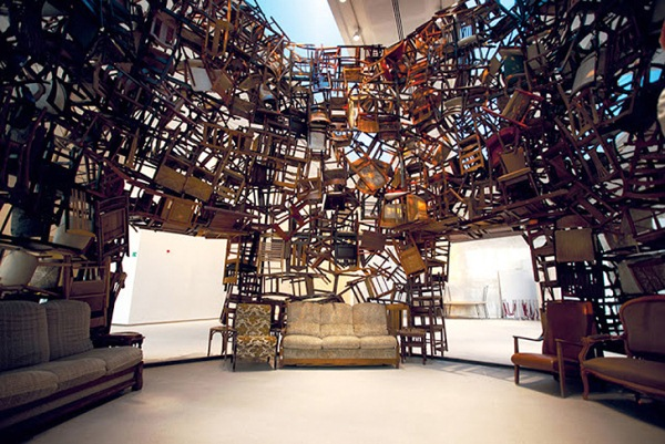 Japanese artist Tadsahai Kawamata went all out for the fourth annual Abu Dhabi art fair. Kawamata, created a round tower formed out of thousands of chairs. The piece, entitled Chairs For Abu Dhabi, is a twenty-foot tall sculpture that took five days to complete.