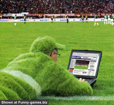 using laptop on soccer ground funny picture