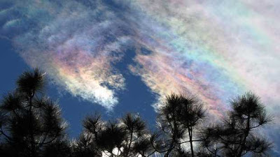 The rainbow colours are caused by ice crystals in the cloud.