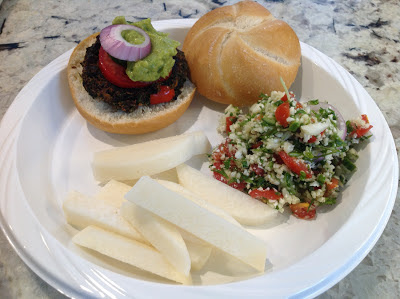 vegetarian burger, jicama slices, and tabbouleh salad on a plate
