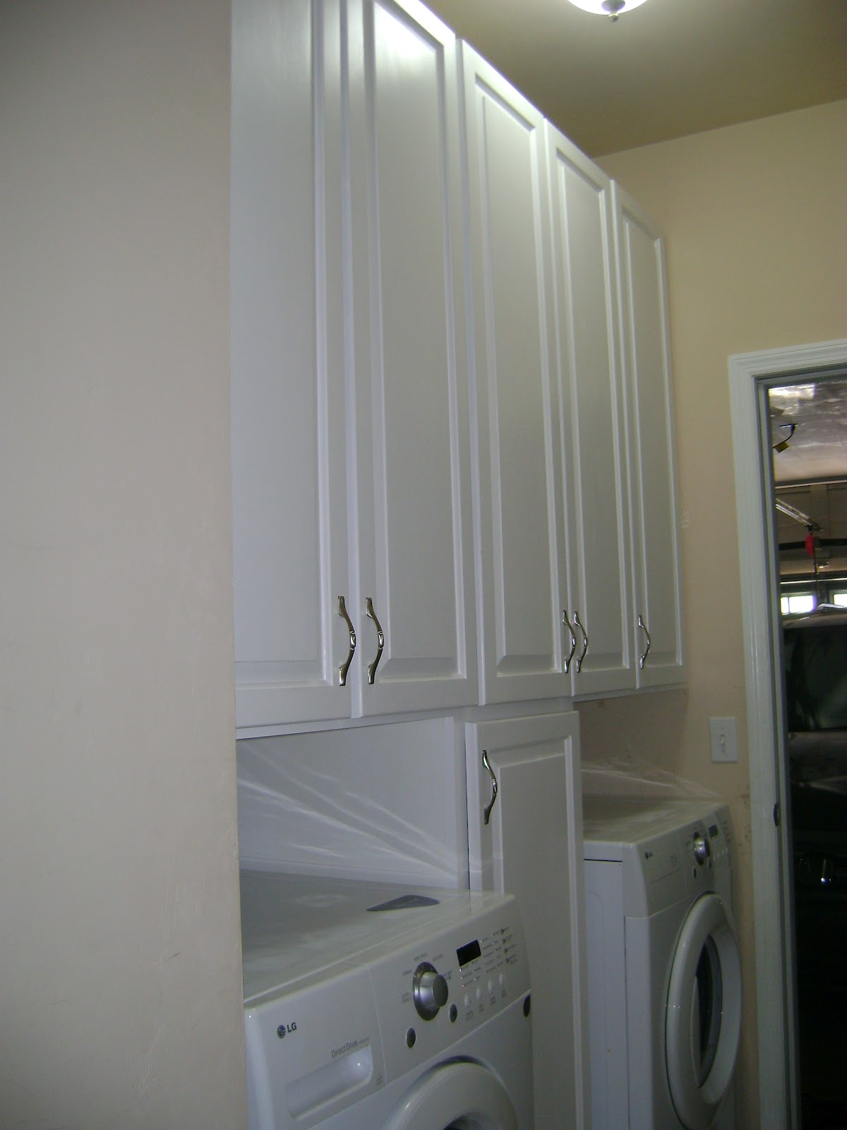 I Love How The Homeowner Wanted The Single Cabinet Between The Washer And  Dryer To Make Use Of That Space As Well.