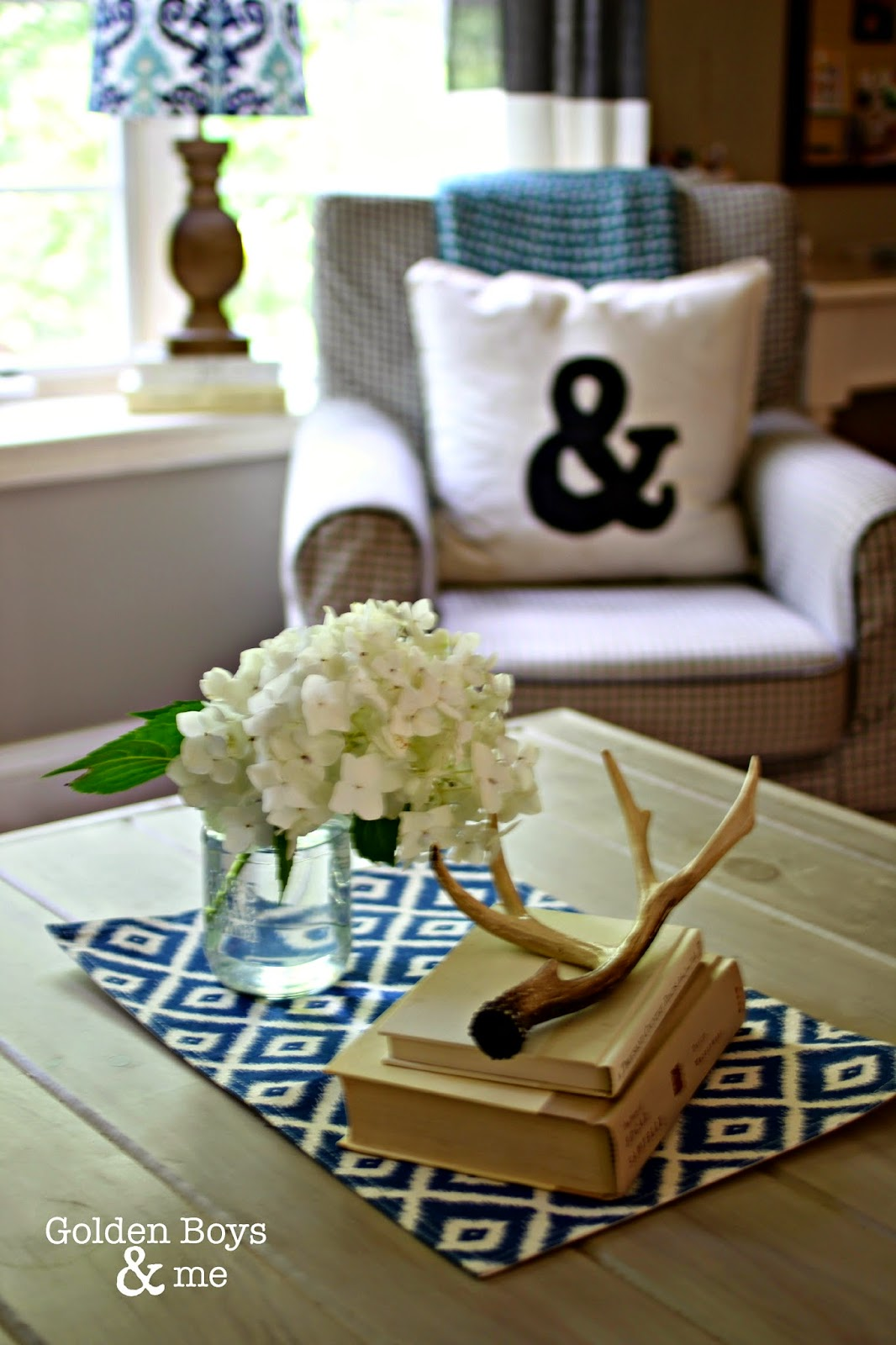 Antler, books, and hydrangea with ampersand throw pillow-www.goldenboysandme.com