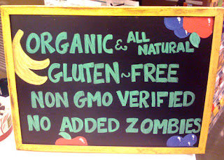 Sign stating Organic, all natural, gluten free, non GMO verified, no added zombies.
