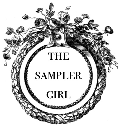 the sampler girl knits and reads