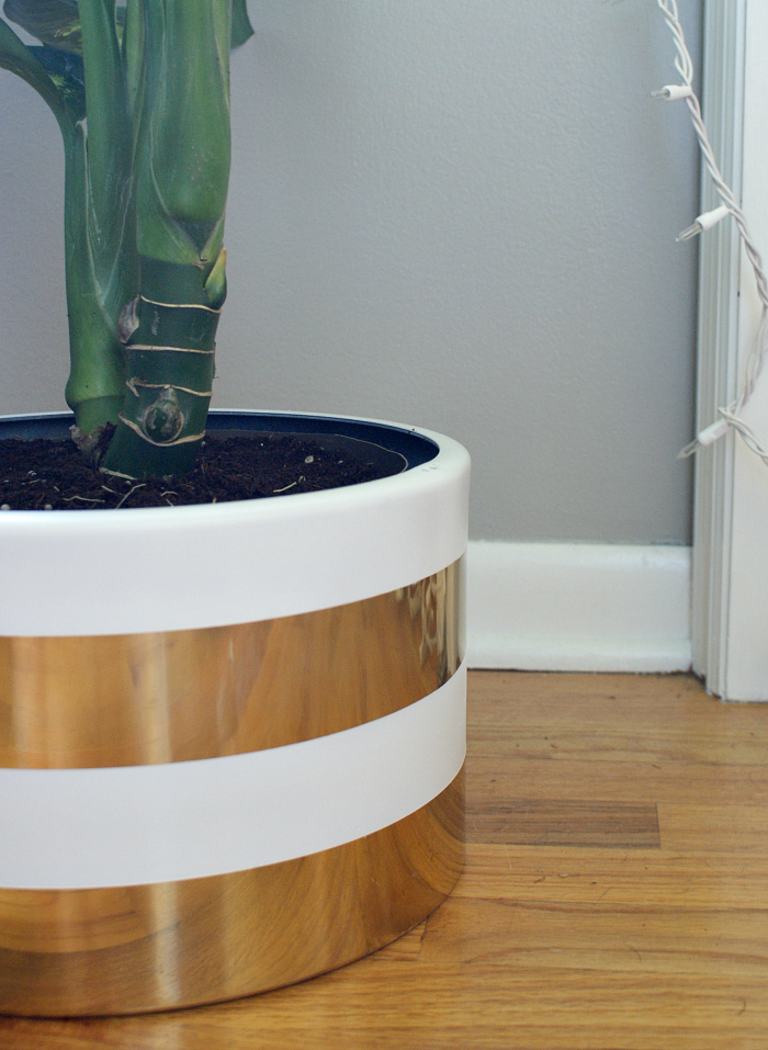 add white stripes to thrift store planter for some instant swank!