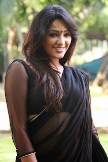 Actress Samruthika  Picture Gallery in Black Saree at Aayirathil Iruvar Movie Press Meet CelebsNext 4.JPG
