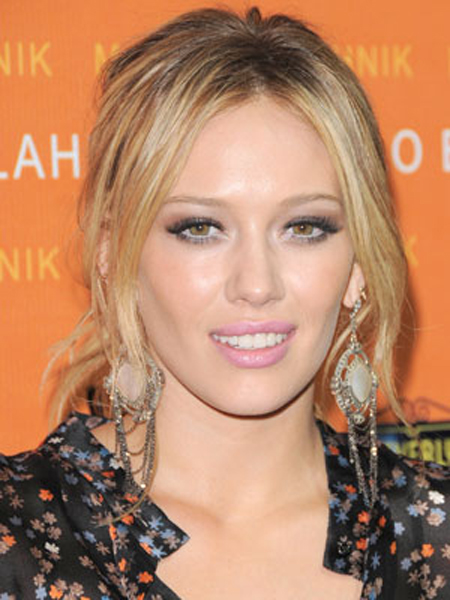 A low ponytail looks casually chic with Hilary Duff's barely-wavy strands