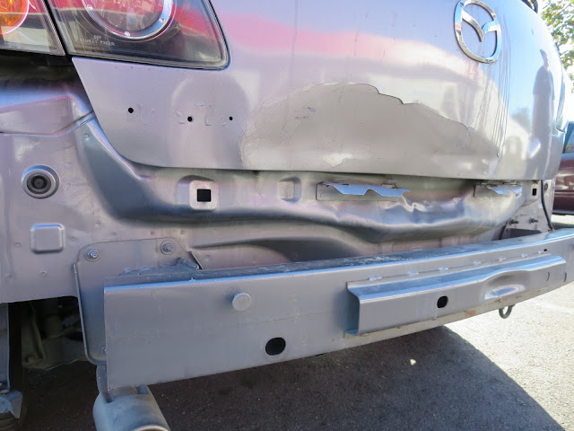 Collision damaged Mazda 3 before auto body repairs & paint at Almost Everything Auto Body