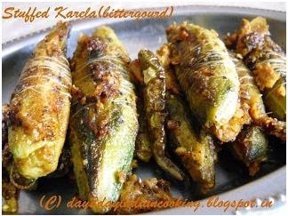 recipe for making stuffed bittergourds with onion and raw mangoes stuffing