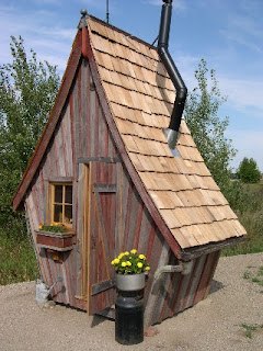 porta potty looks like little cottage