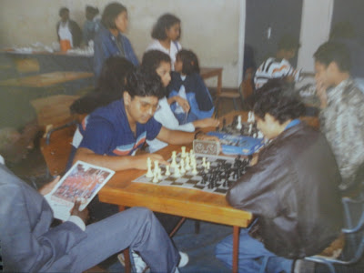 Mehul Gohil in his usual (well in those days) leather jacket takes on Tanzania chess player for a quick blitz game