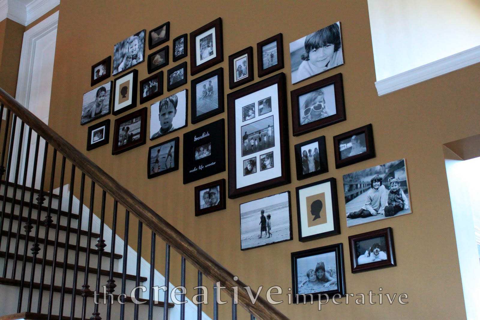 The creative imperative stairway gallery wall for Picture gallery wall