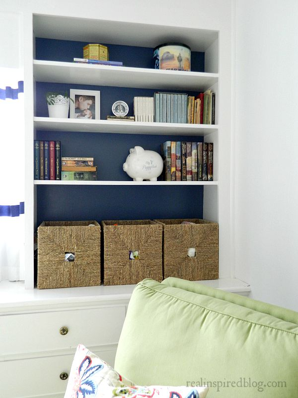 A boys' vintage modern nursery reveal! A simple makeover using a primary color palette to unify everything from toys to vintage heirlooms and sentimental objects. Built in book shelves