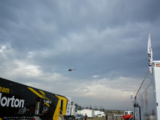 HELICOPTER FLYING OVER CAR RACE SHOW