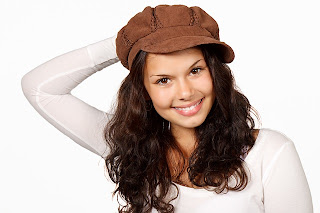 smiling woman with beautiful eyes and smiling face with cap on head