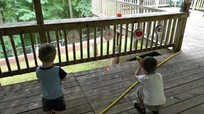 Setting up a squirt gun shooting range.