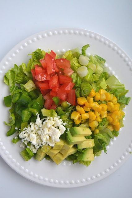 Avocado, Corn and Feta Chopped Salad w/Lime Vinaigrette- finely diced for a burst of flavors in every bite!
