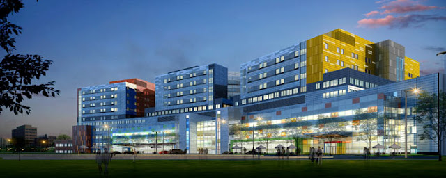 Rendering of McGill University Health Centre's Glen Campus at sunset with blue, red and yellow colors on the facade