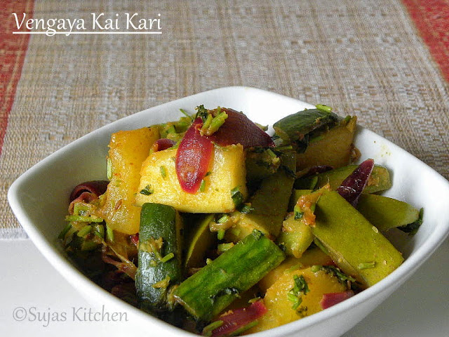 Vengaya Kai Kari, A semi cooked medley of raw Mango, Cucumber & small onions.
