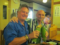FWT and American English Profesor Randy Bollig toasting with sake in Japanese Restaurant, Kobe