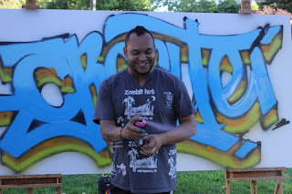 Graffiti Artist AC using Sea blue, Midnight blue, olive and burnt orange.