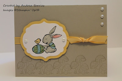 Sahara Sand card base with stamped mushrooms and yellow ribbon. Focal image is a bunny with an Easter Egg and chick.