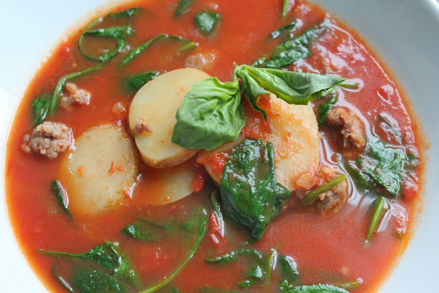 Tomato soup with sausage, spinach, and potatoes