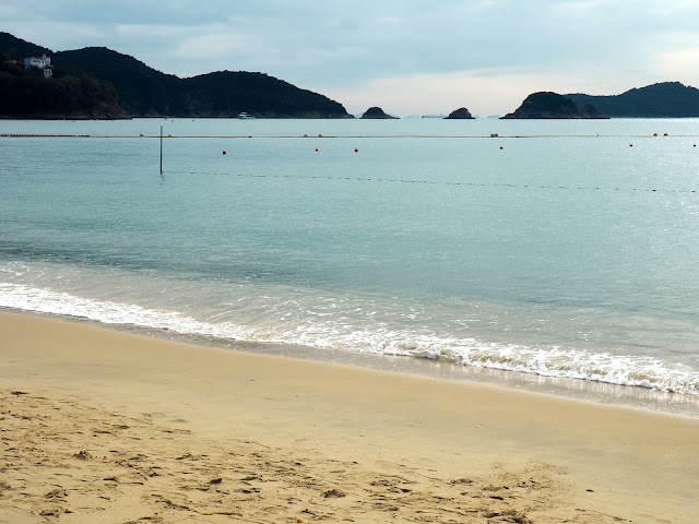 Blue ocean and waves crashing on the sand of Repulse Bay Beach, Hong Kong