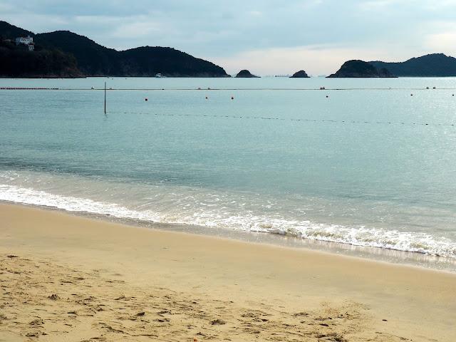 Blue ocean and waves crashing on the sand of Repulse Bay Beach, Hong Kong