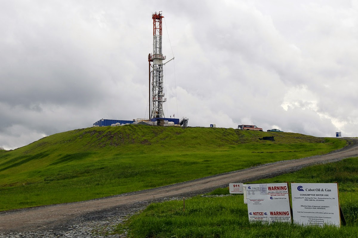 In this file photo from Oct. 14, 2011, a drilling rig is seen in Springville, Pa. State regulators blamed faulty gas wells drilled for leaking methane into the groundwater in nearby Dimock, Pa. It was the first serious case of methane migration said to be related to the Pennsylvania Marcellus Shale gas field drilling boom. (Credit: AP Photo/Alex Brandon, FILE)  Click to Enlarge.