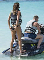 The stunning brunette, Danielle Lloyd, 31, enjoyed her free schedule in a black bikini on Friday, December 11, 2015 as she spent the most romantic holiday with new boyfriend, Michael O'Neill at the beach in Barbados.