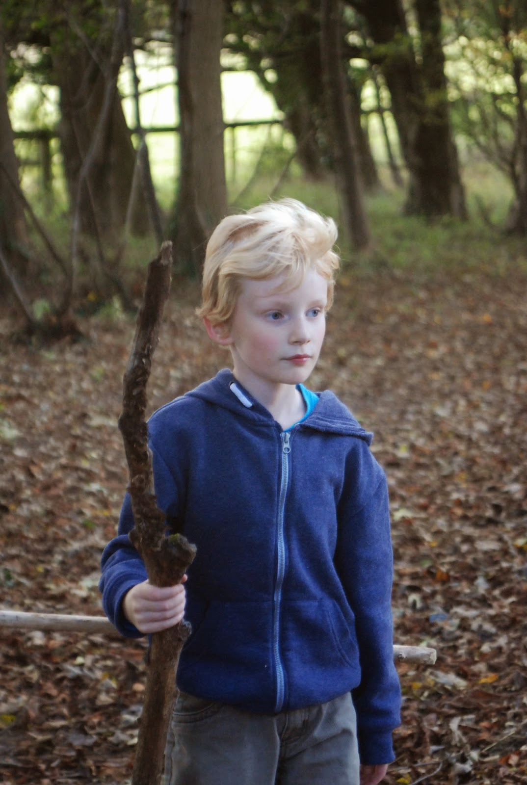 child with stick