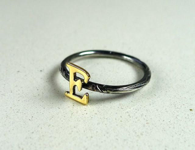 silver distressed ring with gold letter