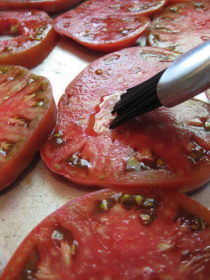 tomato slices on baking sheet