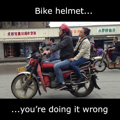 bike helmet meme doing it wrong china
