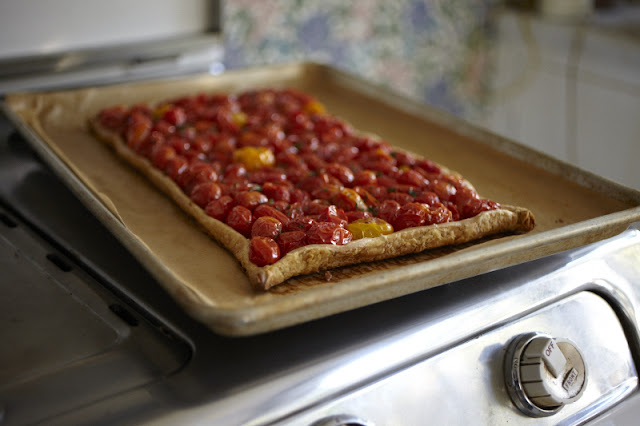 herbed tomato tart with puff pastry and fresh herbs