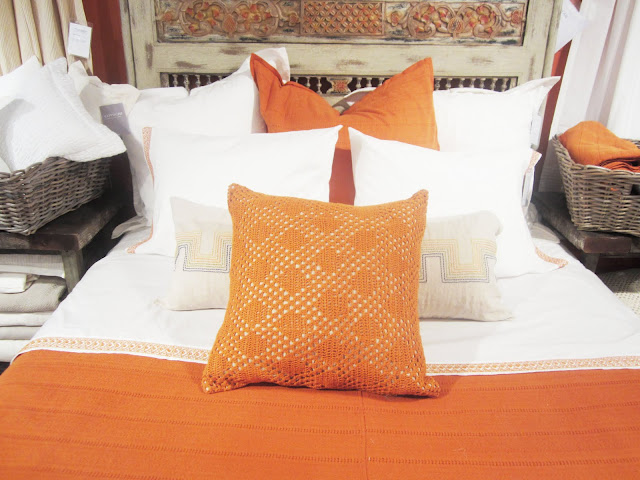 Close up of the orange and white Coyuchi pillows