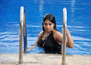 hot and sexy wet charmi in swim suit at swimming pool