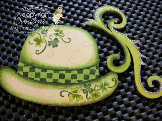 decorate step 2 to paint a green hat lapel pin for St. Patrick's