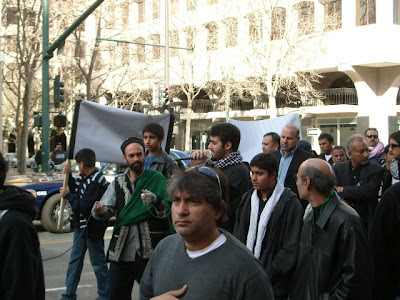 "Shia Association of Bay Area (SABA) members, including Sajjad Mir, Ali Mir (a.k.a. Ishraq Abidi) and Mahdi Falahati parading during their Husayn Day ""Peace"" Walk in downtown San Jose while sporting militancy scarves. Also in this photo, Sajjad Mir, the Chairman of SABA (third from right)."