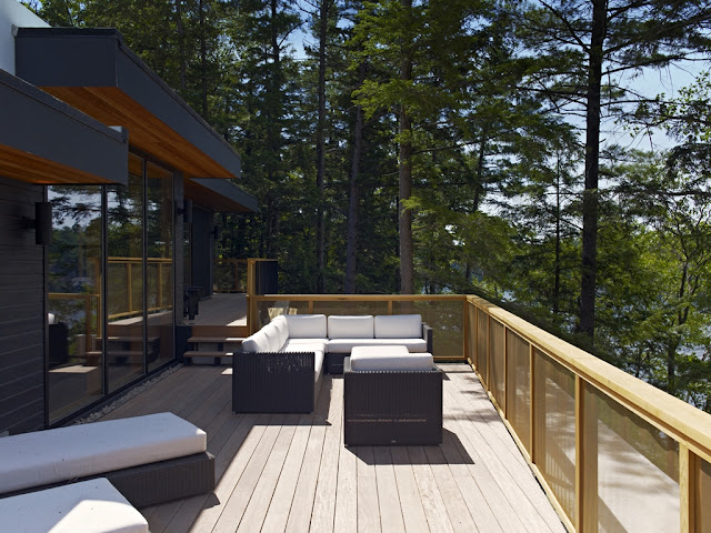 Photo of lovely open terrace with garden furniture up on the forest house